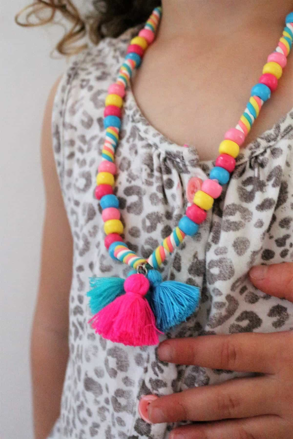 Easy things to make with embroidery thread and FIMO. Cute Kid's DIY Jewellery for girls. Make a bead and tassel necklace for kids. Cute idea for girl's party or party bags or birthday gift.