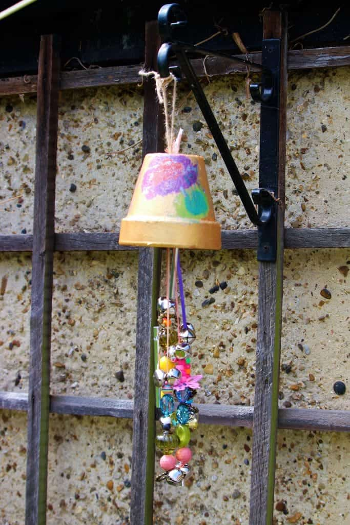 Making garden windchimes for the garden. Kid's craft garden activity. Kid's windchimes for hanging in the garden