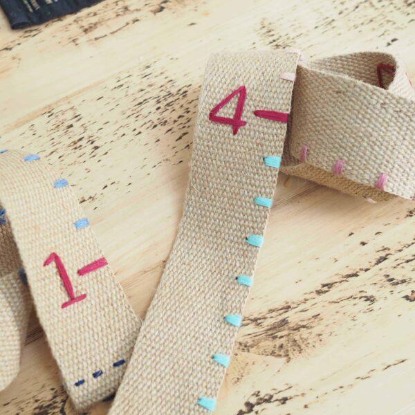 hessian height chart. Embroidery thread. Hand sewn hessian.