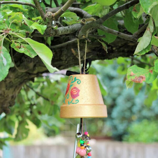Making garden windchimes for the garden. Kid's craft garden activity. Kid's windchimes for hanging in the garden