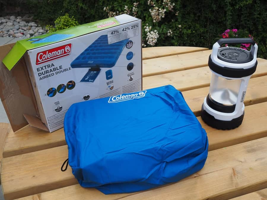 double airbed and lantern for camping