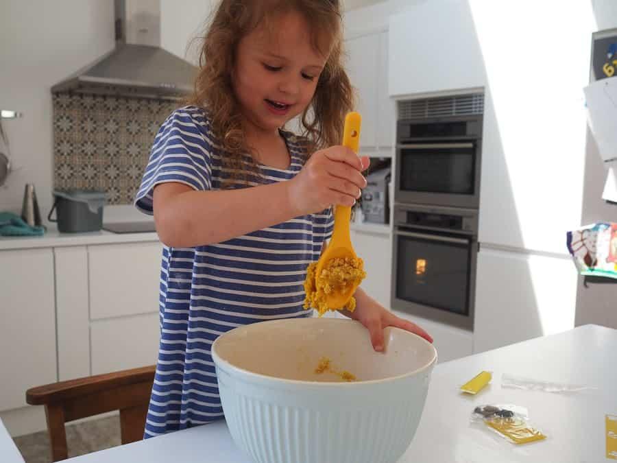 girl baking cookies mixing bowl spoon