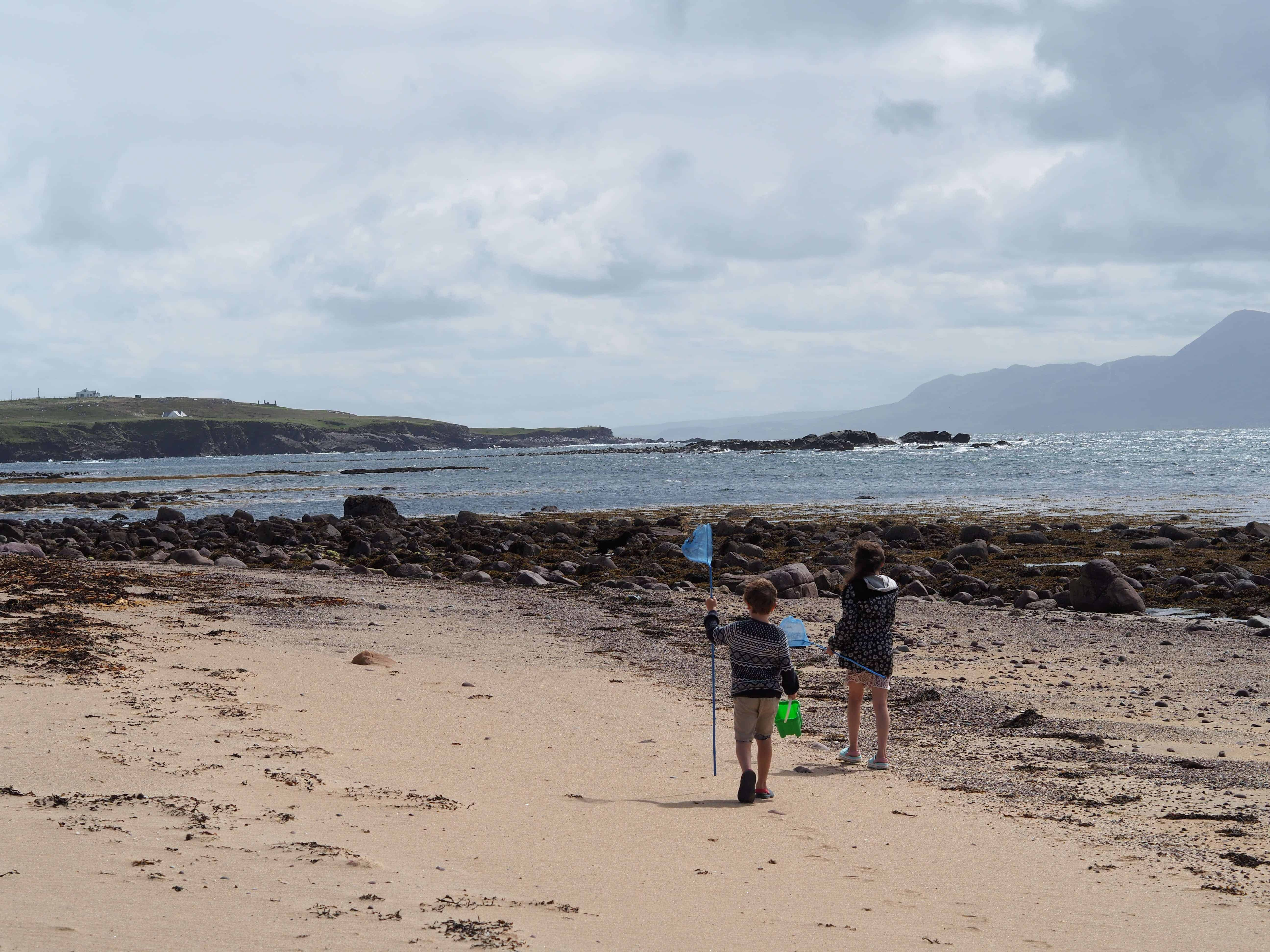 two kids walking on beach