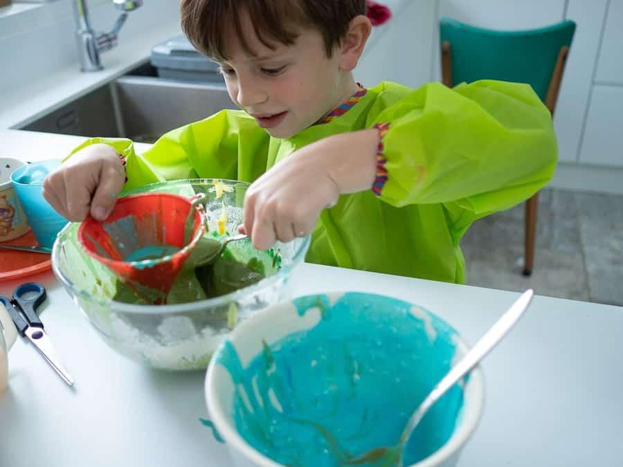 Boy making salt paint